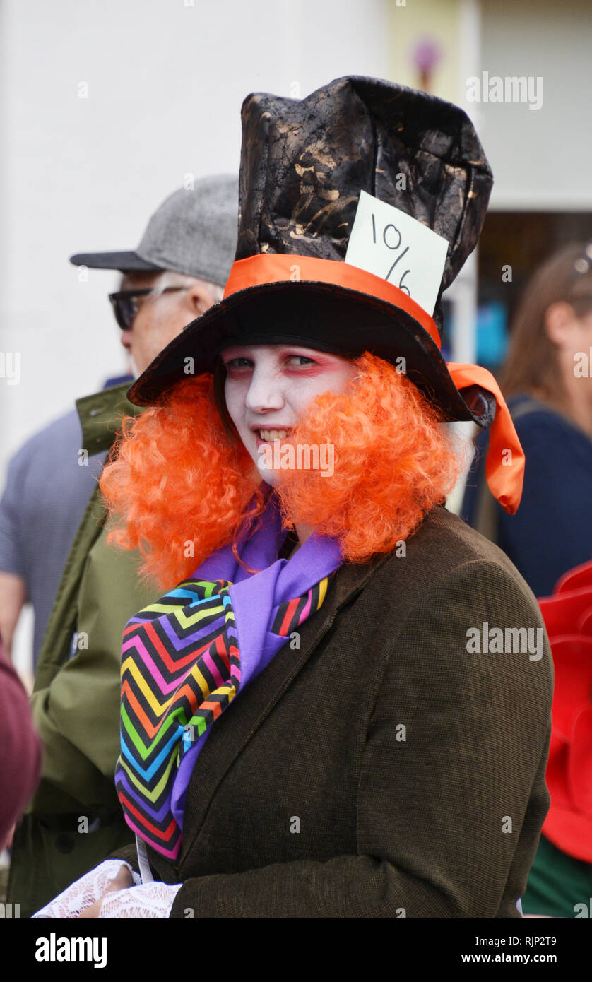 The Mad Hatter playing competitive marbles in the Good Friday Celebrations at Battle, East Sussex, England, UK - Stock Image