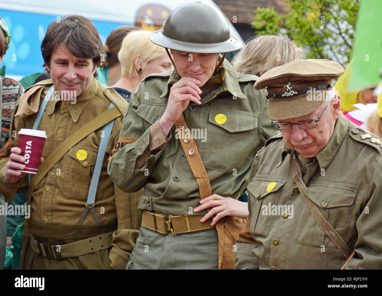 Dads Army team playing competitive marbles in fancy dress at the Good Friday Celebrations at Battle, East Sussex, England, UK - Stock Image