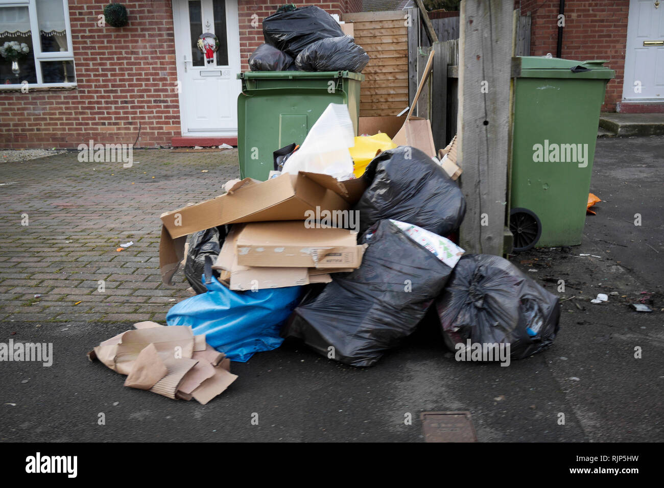 Post Christmas rubbish awaiting collection, outside homes on Lipson Road, Cheltenham.   Picture by Thousand Word Media.  NO SALES, NO SYNDICATION. Con - Stock Image