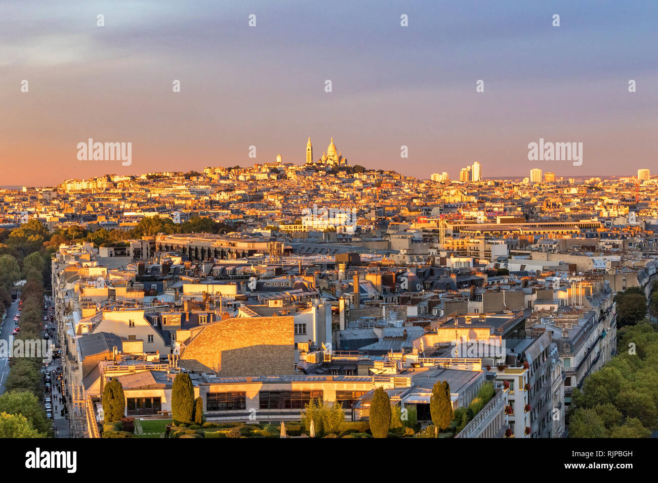 The Sacre-Cœur and Montmartre at sunset from the rooftop of the Arc de Triomphe ,Paris ,France Stock Photo