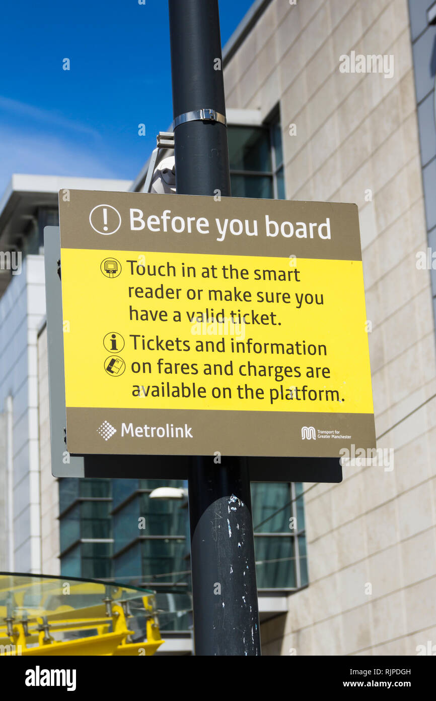 Sign at a Manchester Metrolink tram station warning passengers to make sure they have a valid ticket before boarding. Stock Photo