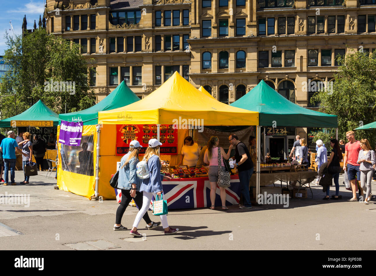 Street food market stalls in Exchange Square, Manchester, outside the old Corn Exchange. Stock Photo
