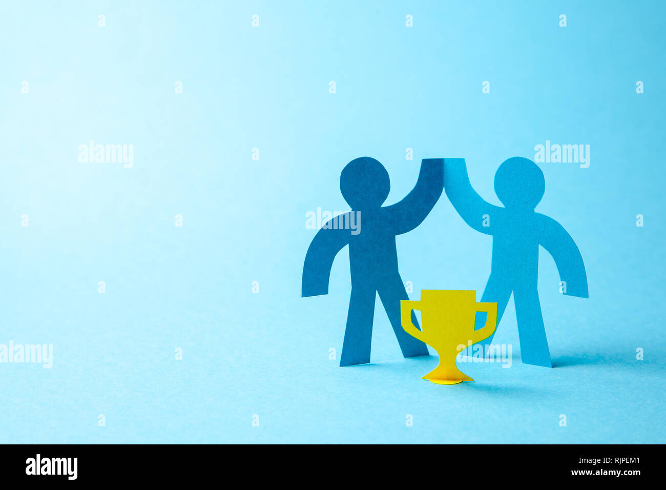 Successful business team winner holds gold cup in his hands. Team building. Leader and Workers Reach the Goal. Copy space for text. Stock Photo