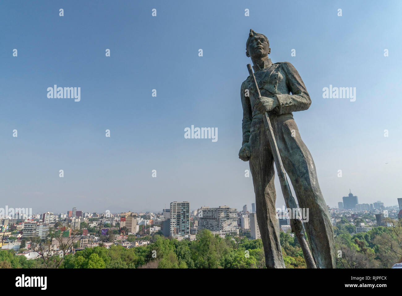 Chapultepec Castle mexican statue and mexico city skyline - Stock Image