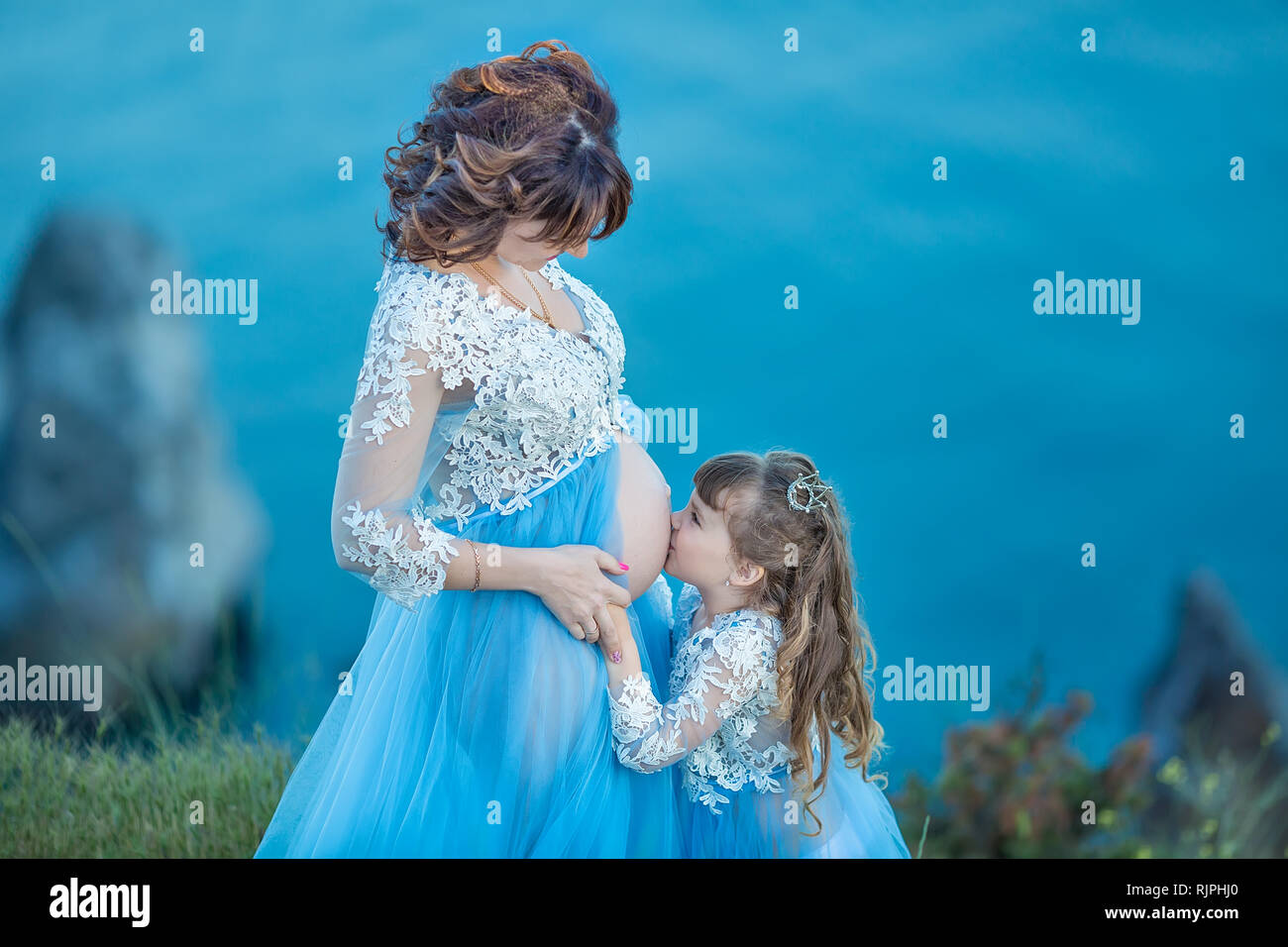 e3611161cf5c9 Beautiful Pregnant Woman in romantic flying dress at sea shore near ancient  ruins of Greece city