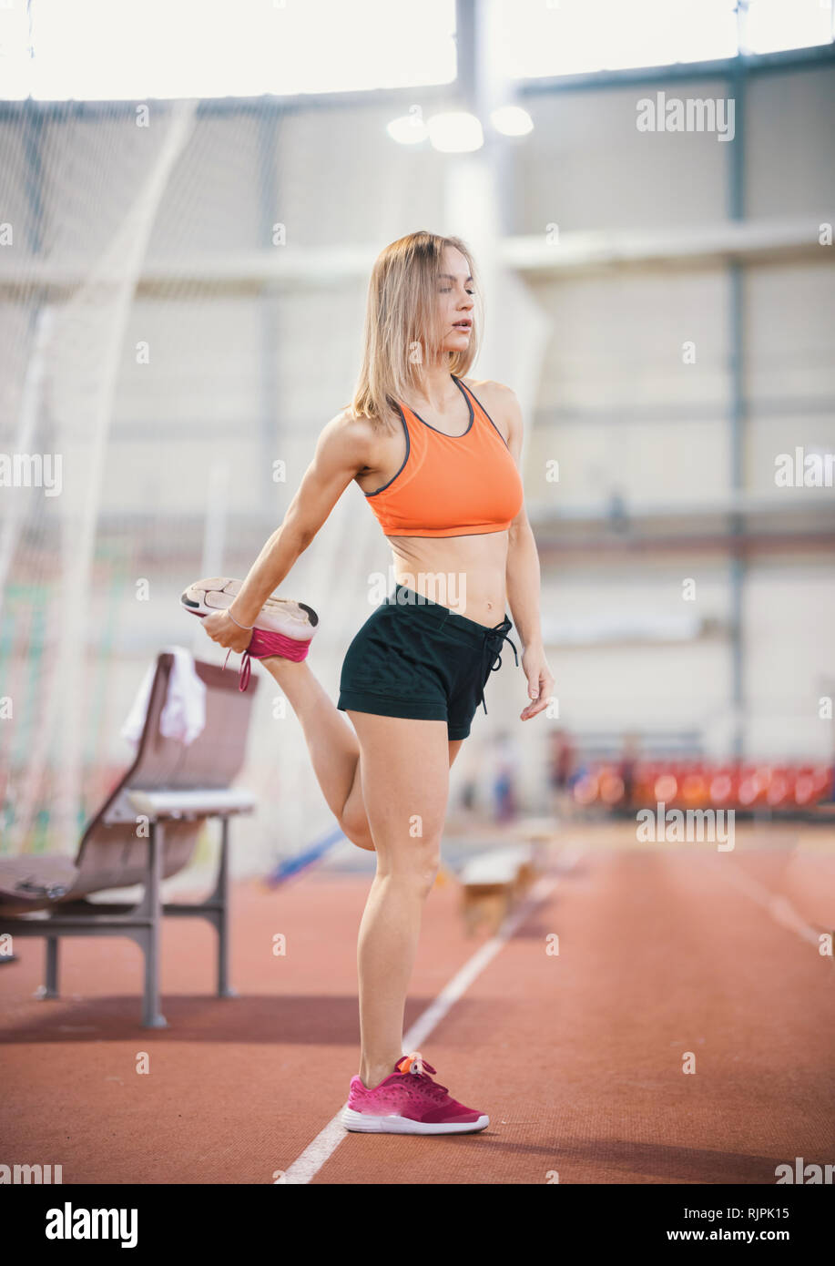 Young Fit Athletic Woman Stretching Her Legs Stock Photo Alamy A picture of andrea osorio. https www alamy com young fit athletic woman stretching her legs image235296465 html