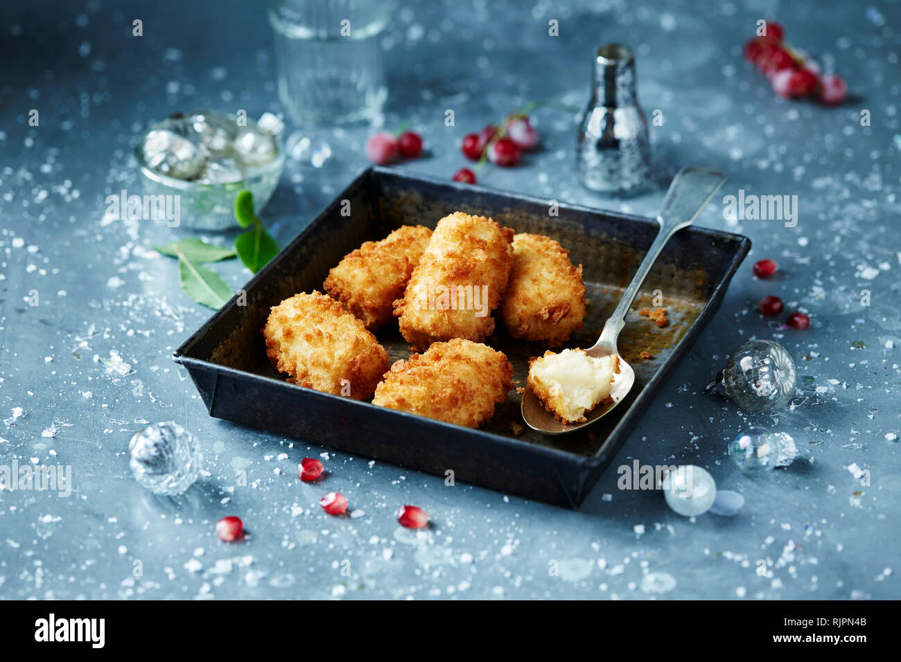 Christmas Dinner In A Tin.Potato Croquettes In Roasting Tin Seasonal Christmas Food