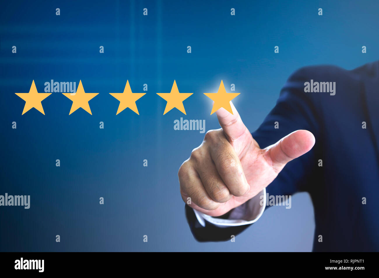 Hand of a man giving high score with five golden stars rating for movie or television programme or anything that having the required qualities. Show t - Stock Image