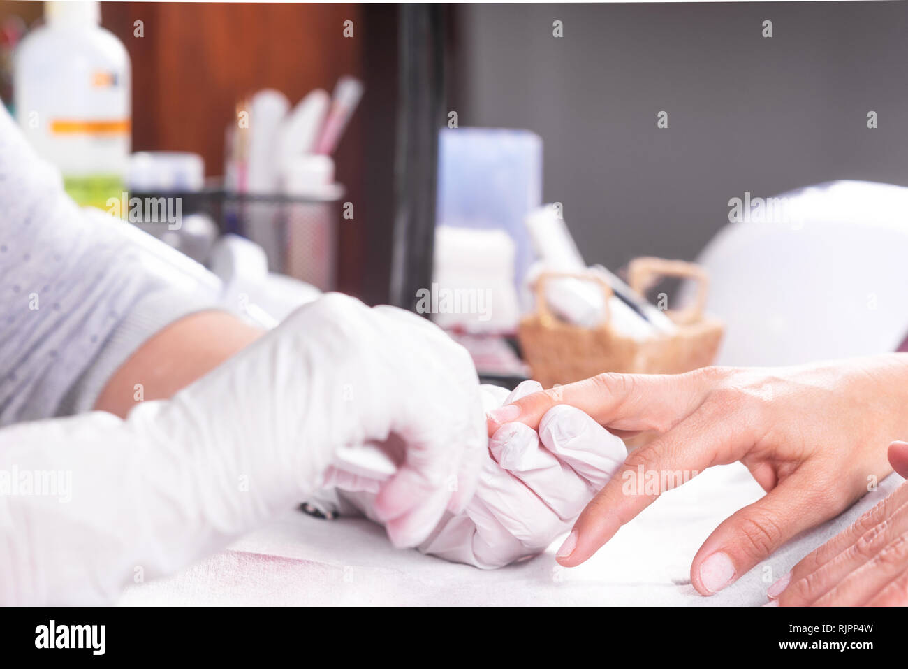 Professional manicure process, beautician file nails to a customer . - Stock Image