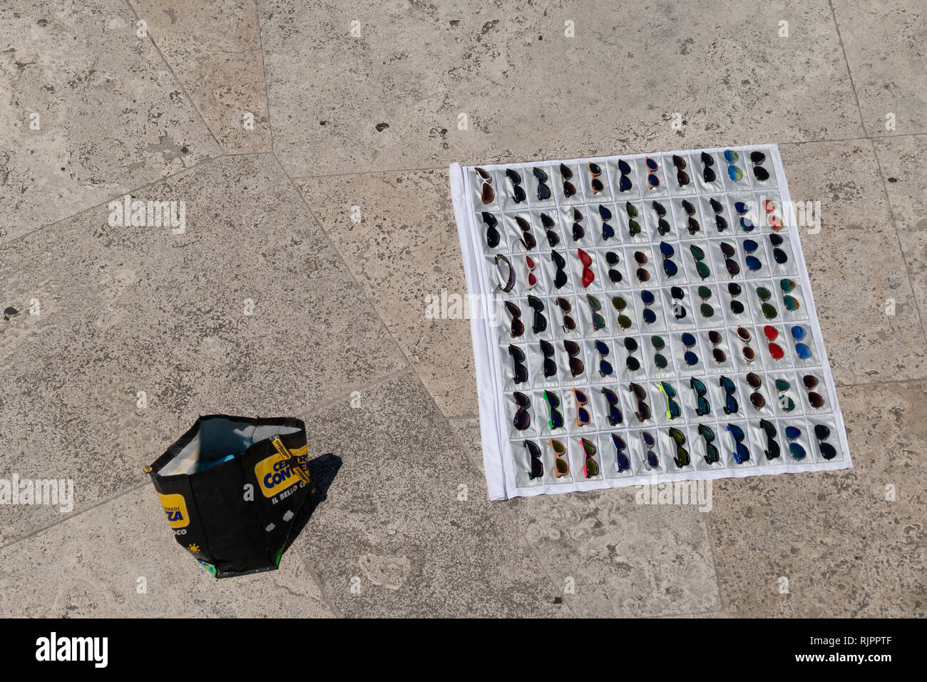 sunglasses, product counterfeiting, display by an illegal street vendor in Rome, Italy - Stock Image