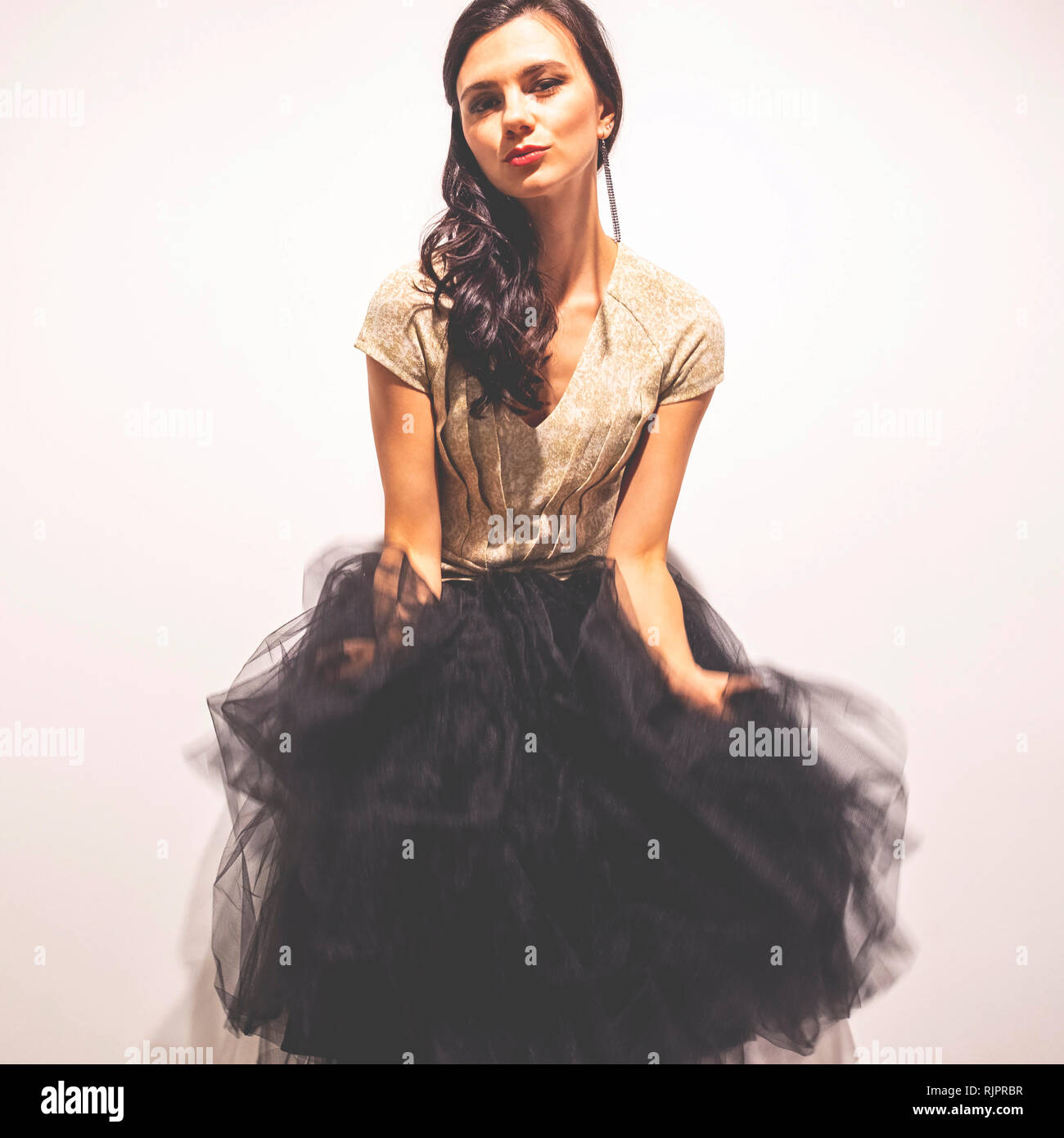 Woman holding tulle skirt dancing Stock Photo