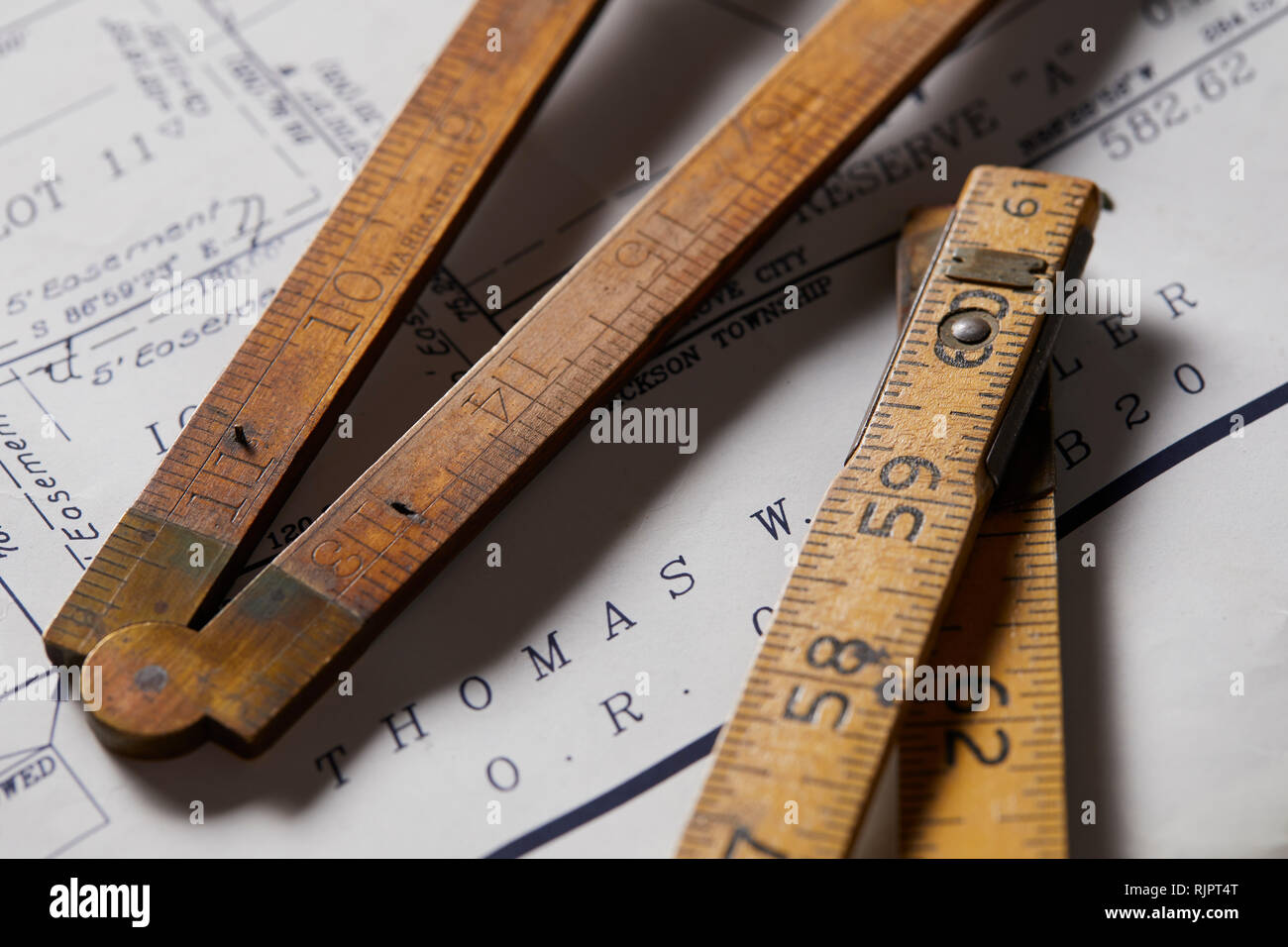 Vintage rulers on property map, close up - Stock Image