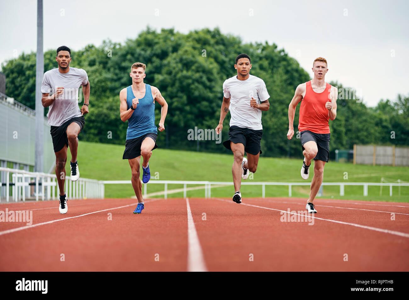 Runners training on running track - Stock Image
