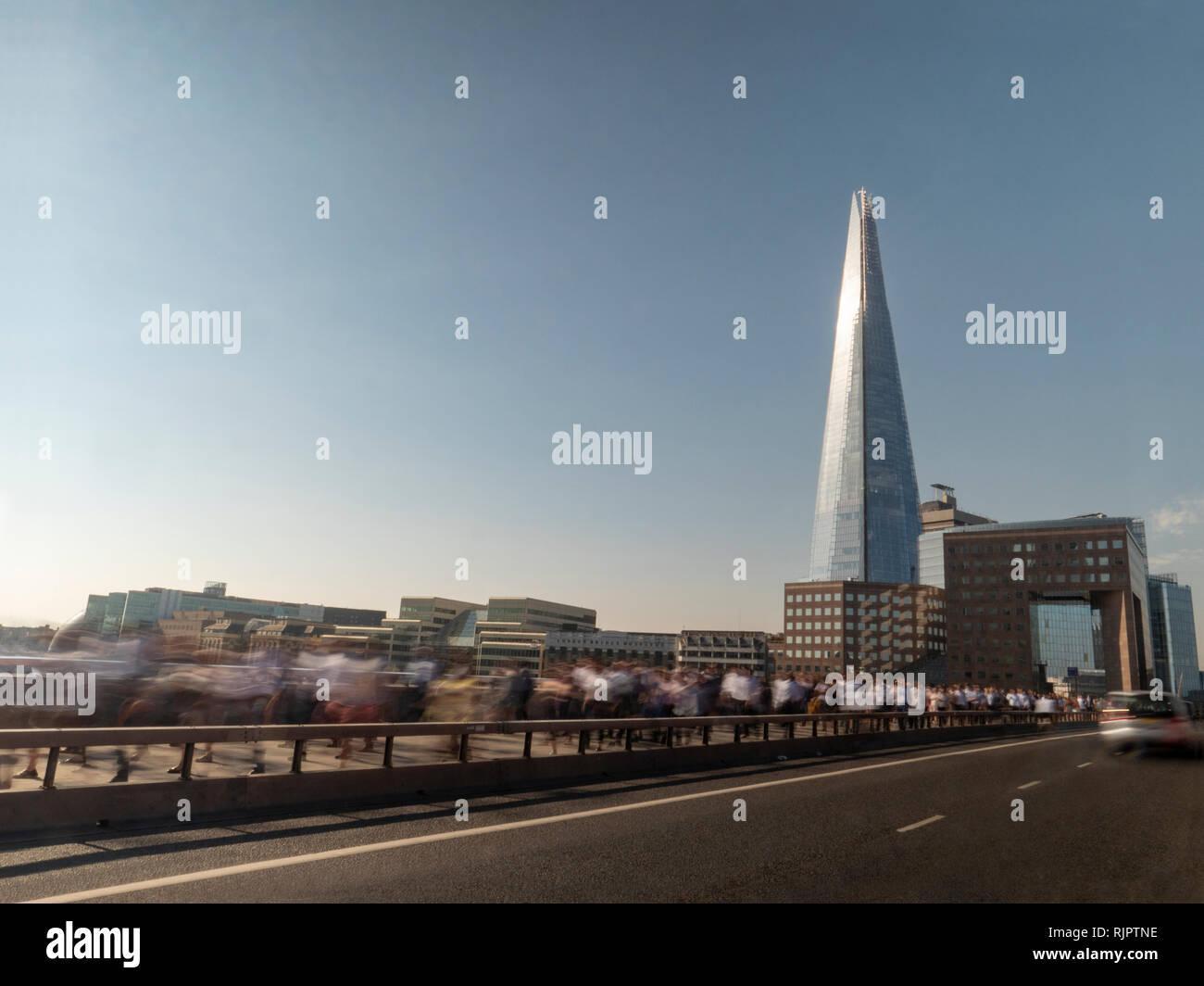 People walking along London Bridge, London, UK - Stock Image