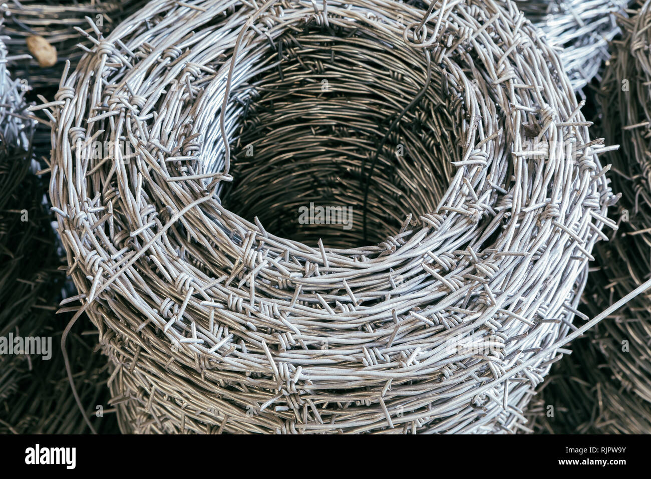 Barbed wire fence safety guard products - Stock Image