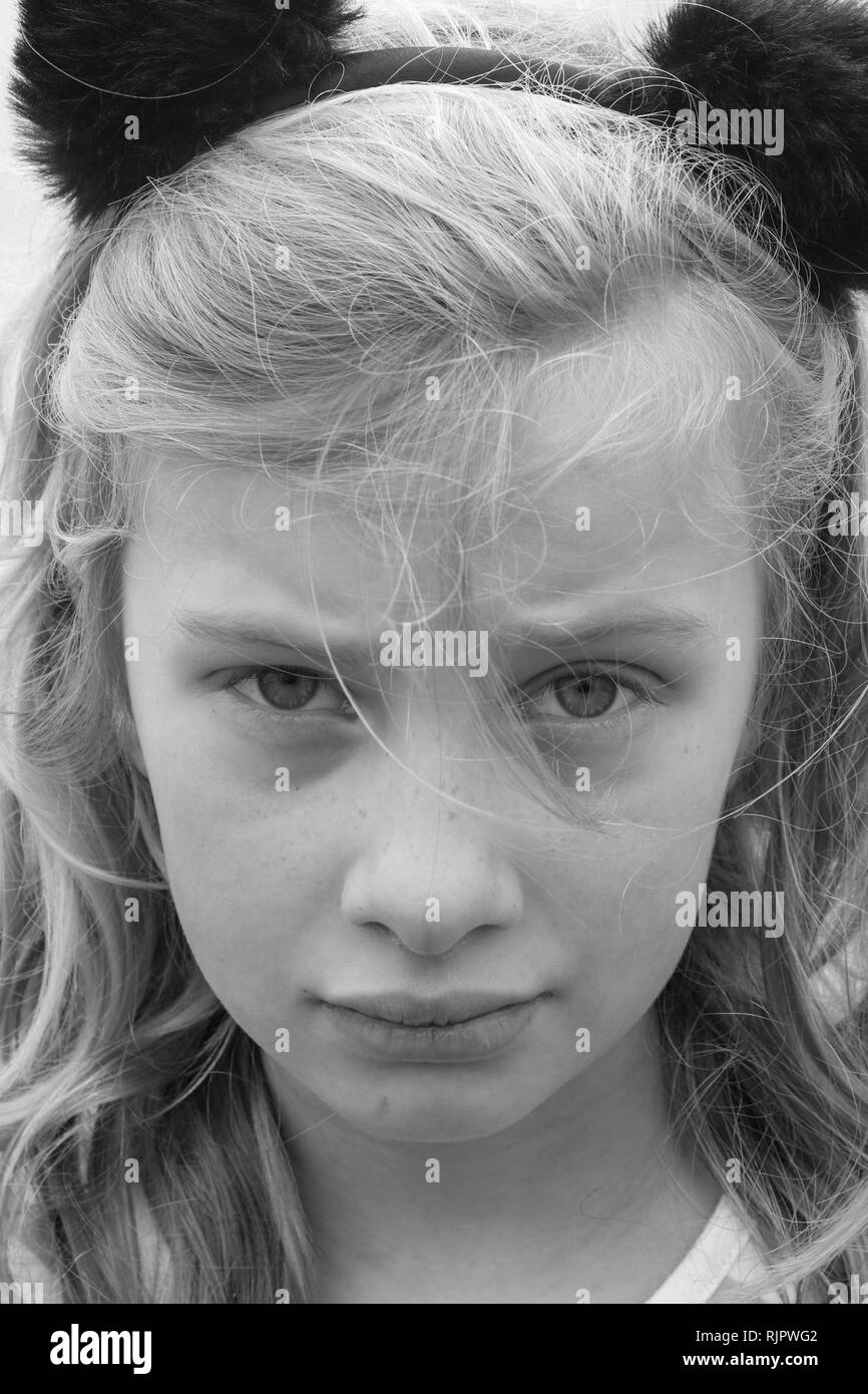 Black and white portrait of an unhappy sad hurting preteen girl stock