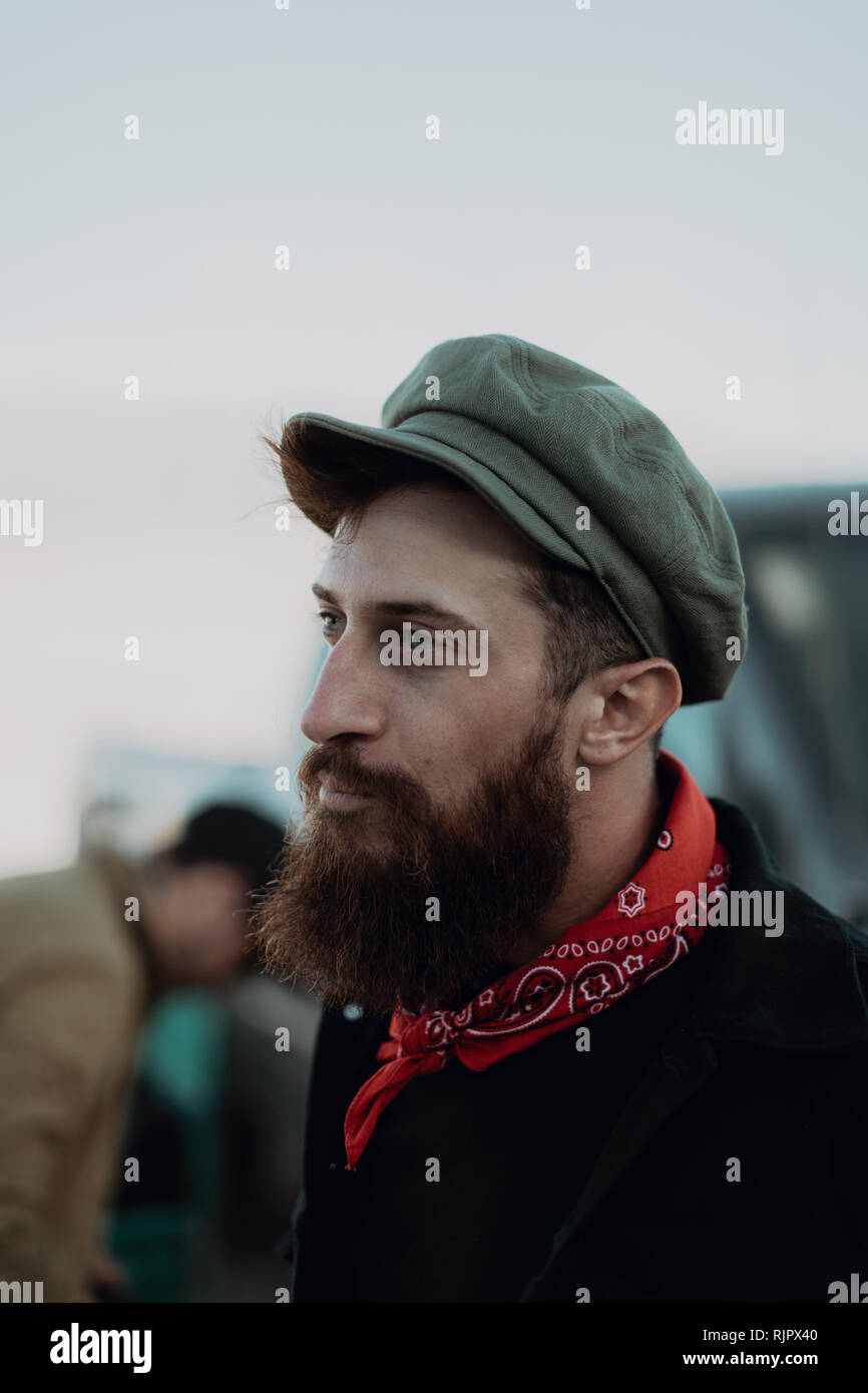 Bearded man in cap and neckerchief - Stock Image