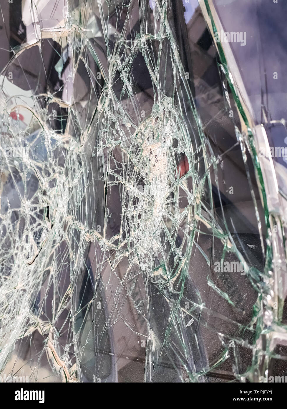 Car windshield shattered with stones by vandals. - Stock Image