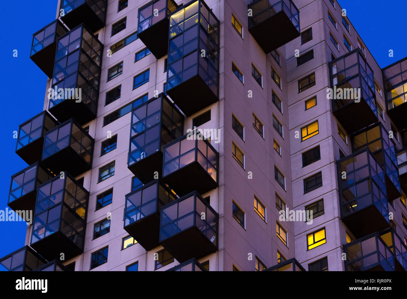 Late night view of council flats. Exterior of complex building in the city Stock Photo
