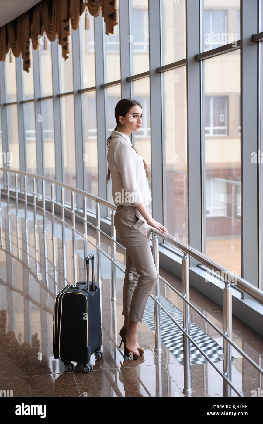 Young woman at international airport. Female passenger at termin - Stock Image