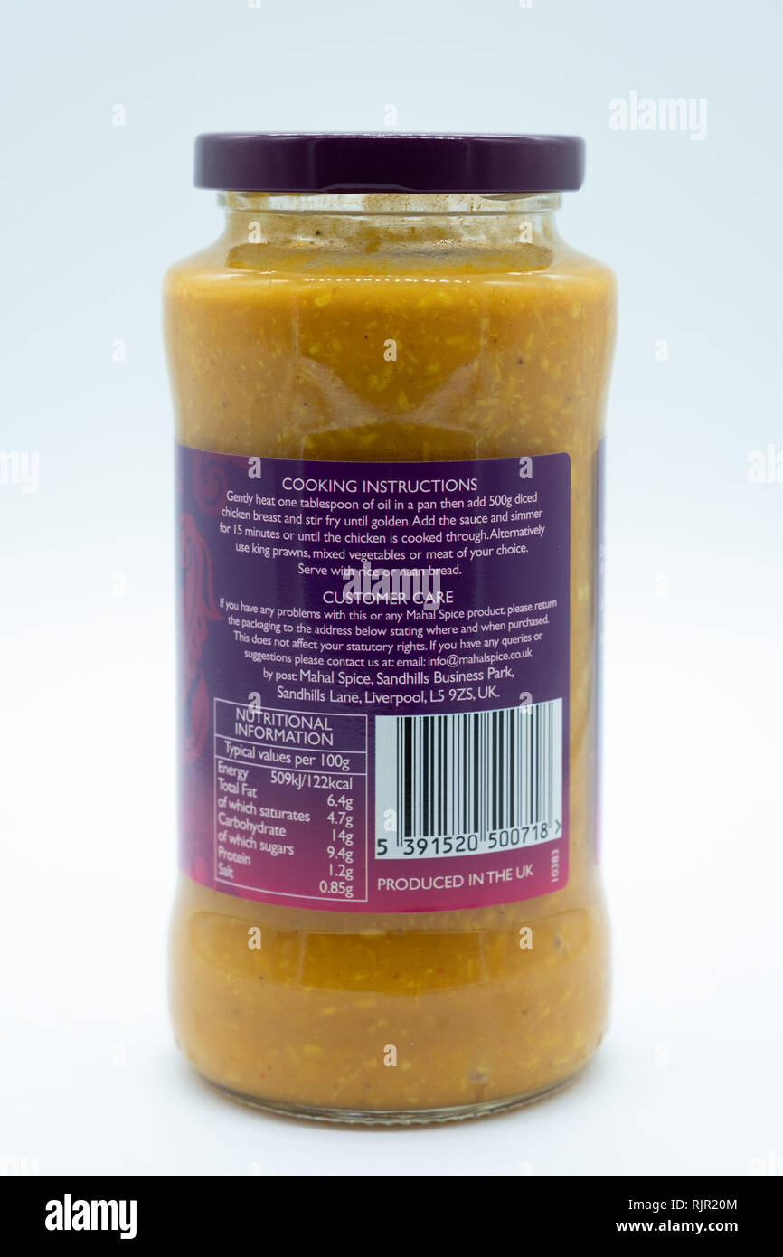 Largs, Scotland, UK - February 04, 2018: A glass jar of Mahal Spice branded korma sauce in a recyclable glass jar and rear label containing nutritiona - Stock Image