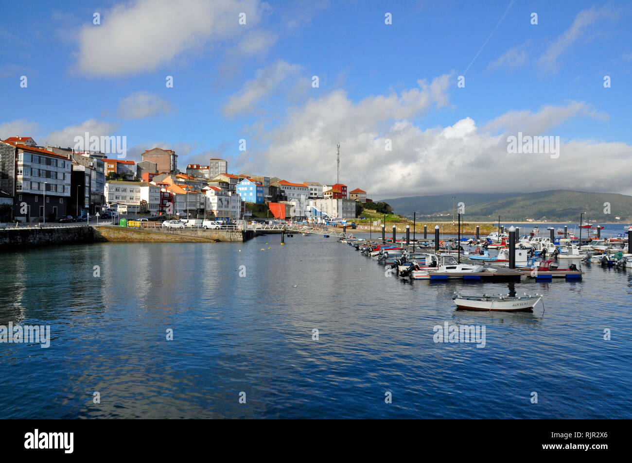 The harbour in fishing village of Fisterra, the final destination for pilgrims on the Way of St.James. - Stock Image