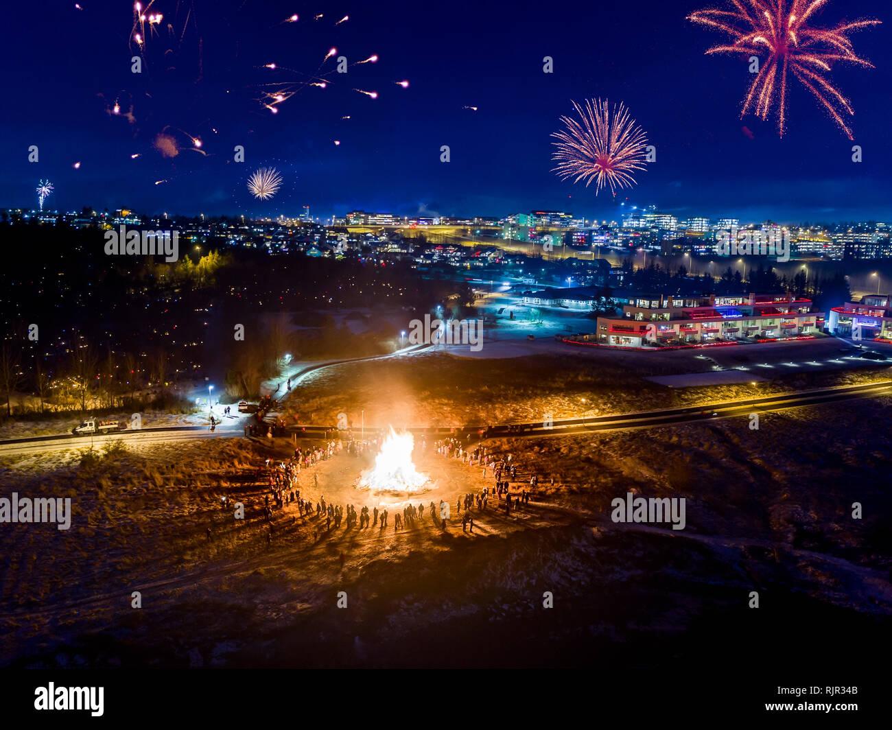 New Year's Eve Celebrations with bonfires and fireworks, Reykjavik, Iceland - Stock Image