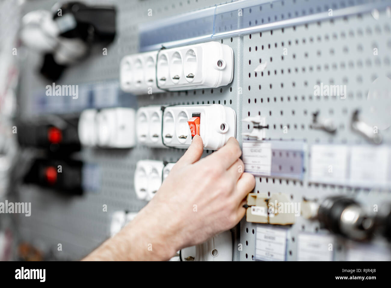 Choosing elecrical sockets in the shop with electrical goods, close-up view Stock Photo