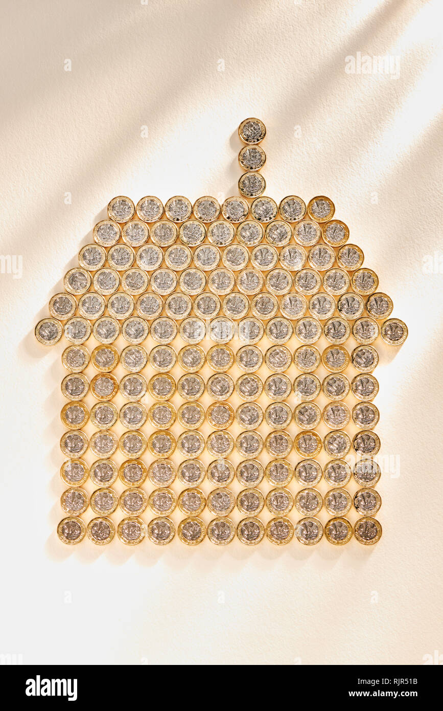Collection of £1 Pound Coins in the Shape of a House Stock Photo