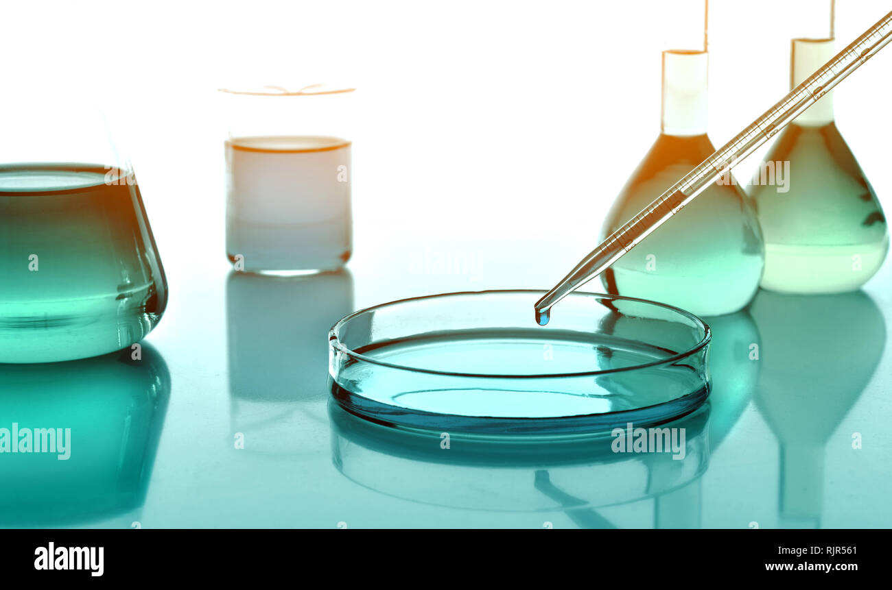 Laboratoy glassware with chemicals and liquids, chemistry science - Stock Image