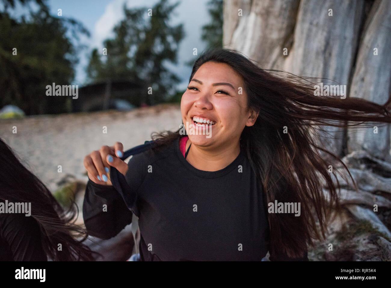 Woman swinging hair, Kailua Beach, Oahu, Hawaii - Stock Image
