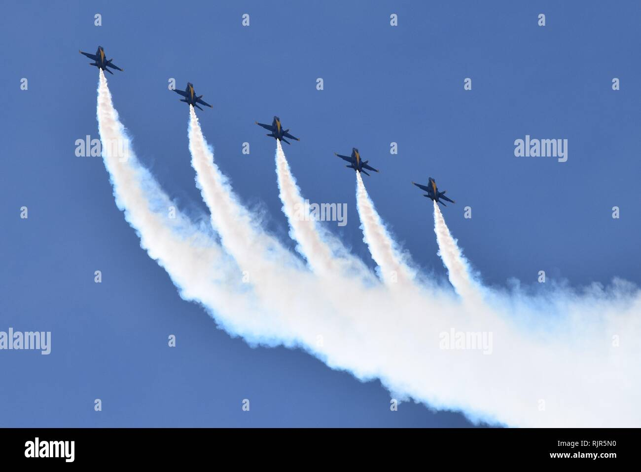 The US Navy demonstration team Blue Angels fly the F/A-18 Hornets in precise formation at the Luke Air Force Base airshow in Arizona in 2018. - Stock Image
