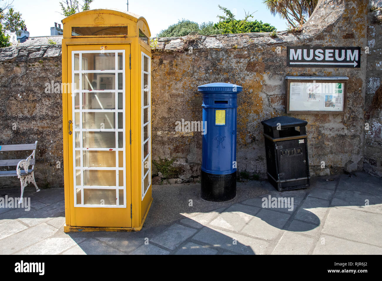 Telephone box and postbox by the museum entrance, top of the High Street, St Anne's, Alderney. - Stock Image