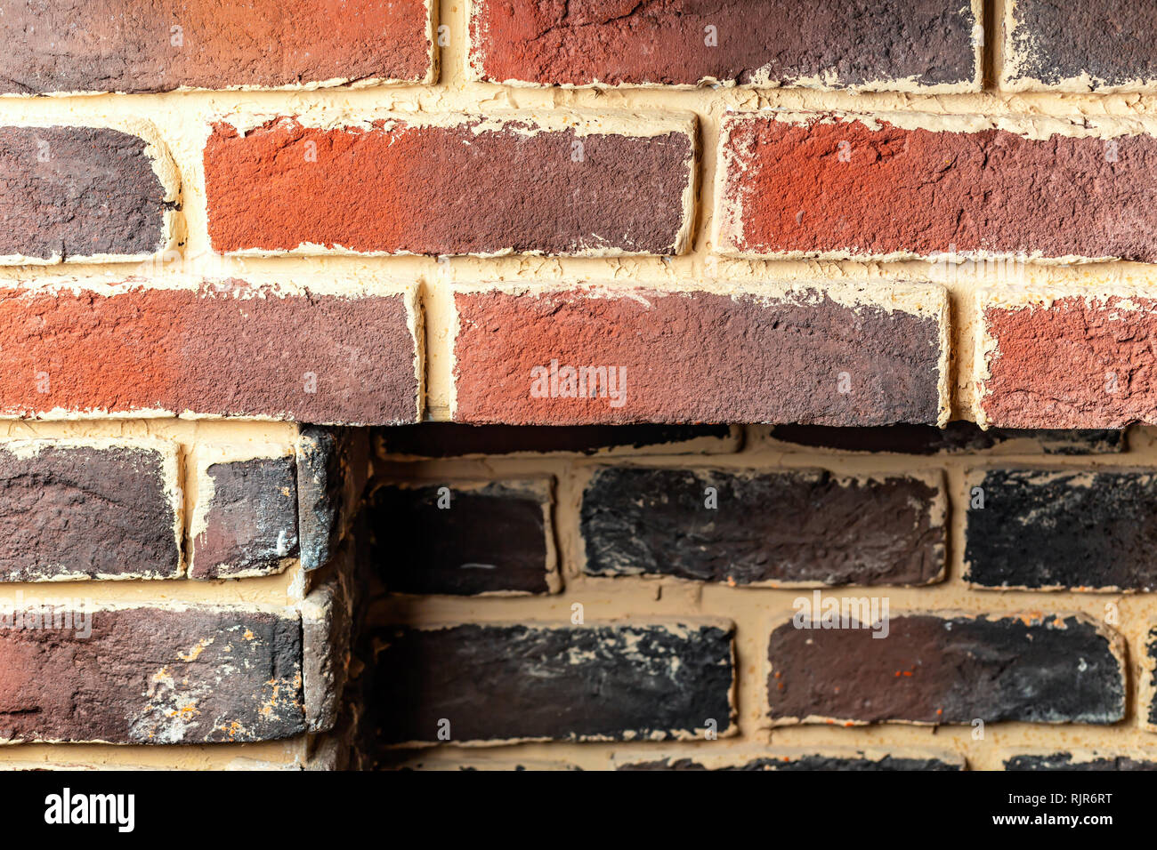 Fragment of a brick wall fireplace with a rectangular niche - Stock Image