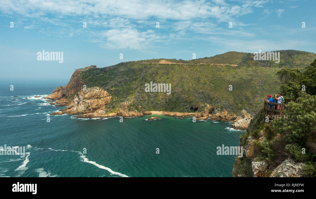 People taking photographs of the view at West Head from East Head lookout at Knysna Head, Garden Route, South Africa - Stock Image