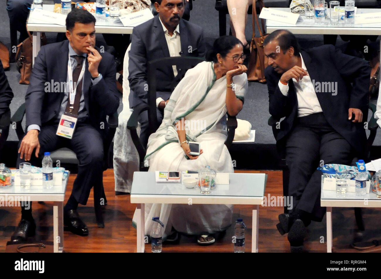 West Bengal Chief Minster Mamata Banerjee (middle) along with JSW Group Managing Director Sajjan Jindal (left) and Reliance Industries Chairman Mukesh Ambani (right) during theinauguration of Bengal Global Business Summit 2019. (Photo by Saikat Paul/Pacific Press) - Stock Image