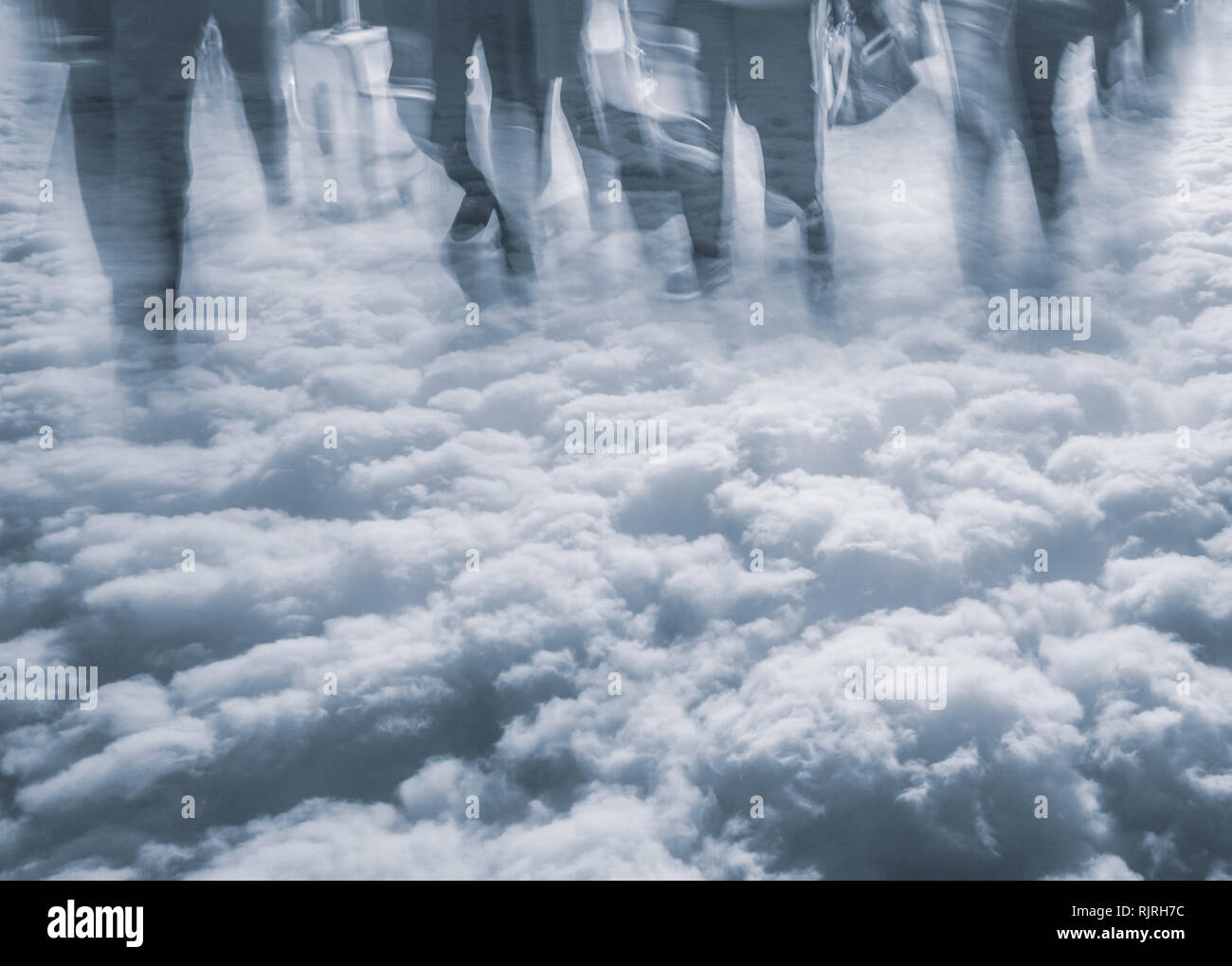 double exposure of people walking in the clouds - travelling or rushing to get somewhere - Stock Image