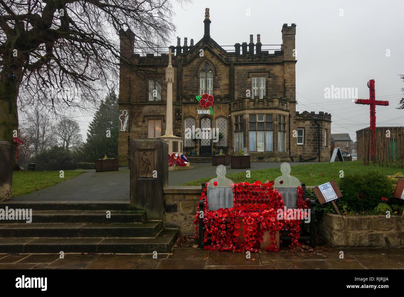 Remembrance Day display with lots of red poppies outisde The Grange,   Burley-in-Wharfedale - Stock Image