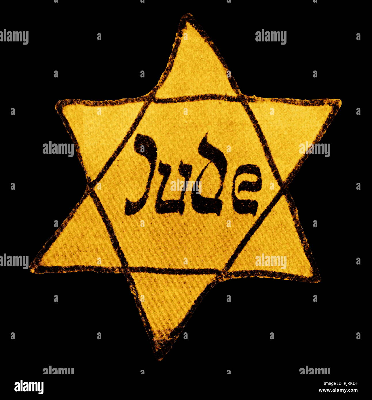 Jews throughout Nazi-occupied Europe were forced to wear a badge in the form of a Yellow Star as a means of identification - Stock Image