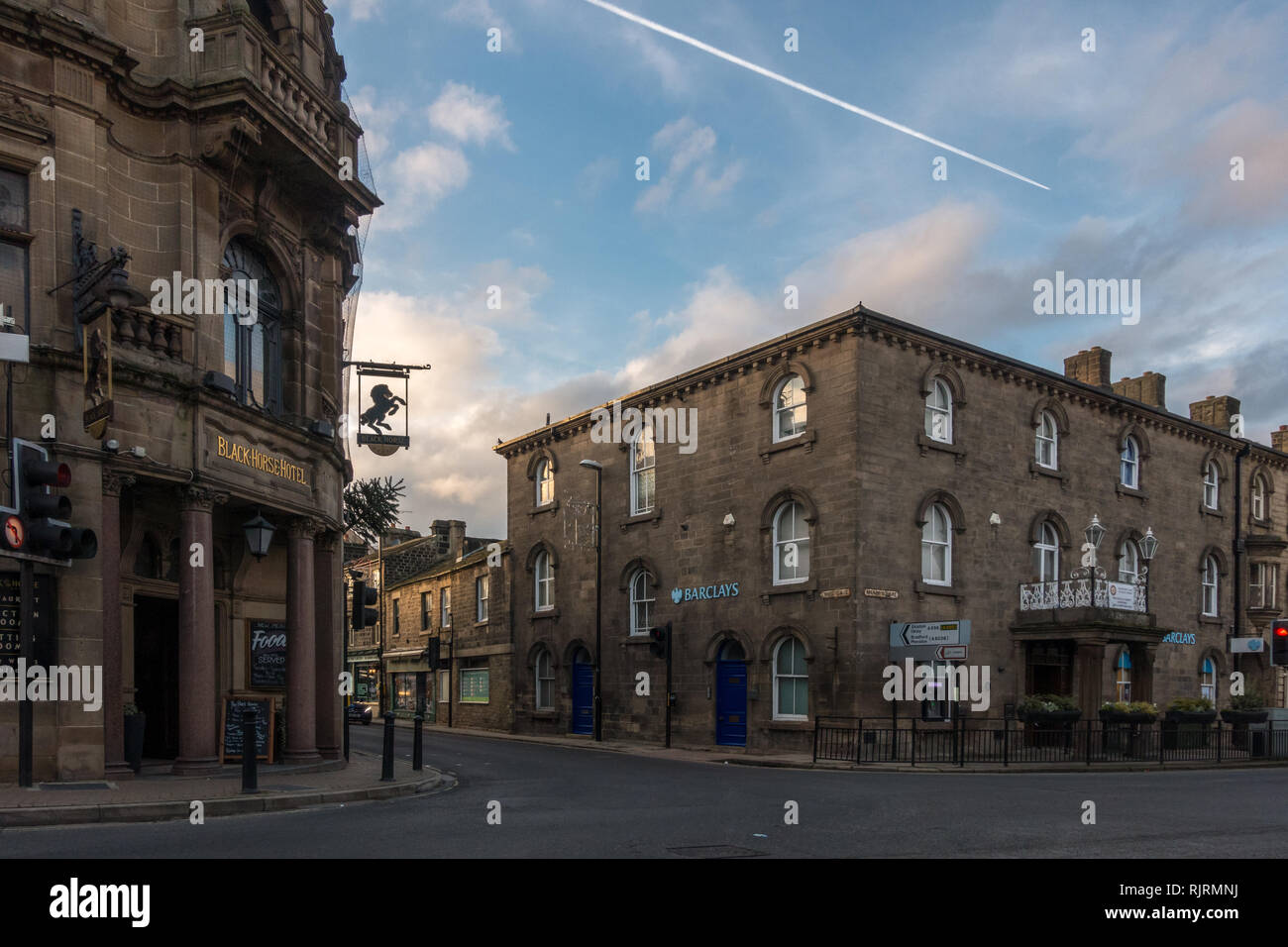 Crossroads in the centre of Otley market town looking at Barclays bank and the Black Horse hotel on a beautiful evening, West Yorkshire - Stock Image