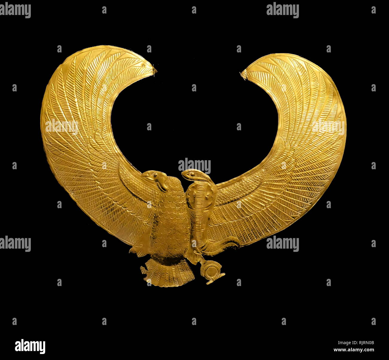 Replica gold pectoral in the shape of a vulture; from the Tomb of King Tutankhamen. Howard Carter (1874 - 1939); British archaeologist and Egyptologist who became world-famous after discovering the intact tomb (designated KV62) of the 18th Dynasty Pharaoh, Tutankhamen (colloquially known as 'King Tut' and 'the boy king'), in November 1922. - Stock Image