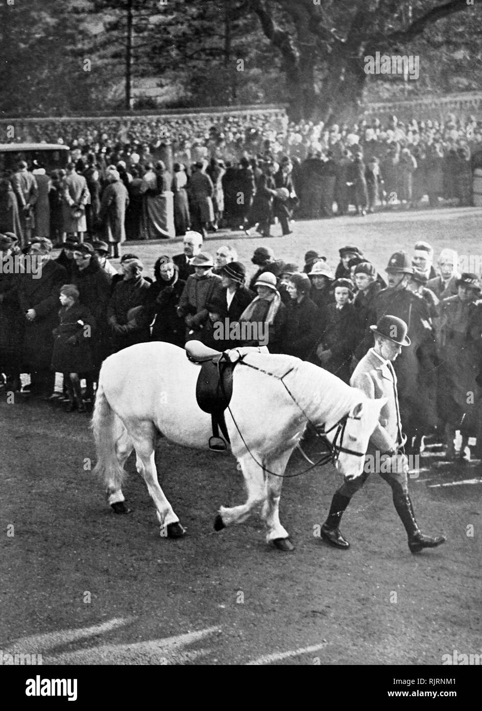 Jock' the King's horse is taken from Sandringham where the King died for the start of the funeral of King George V (1936); King of the United Kingdom and the British Dominions, and Emperor of India, from 6 May 1910 until his death in 1936. the cortege leaves Sandringham. - Stock Image
