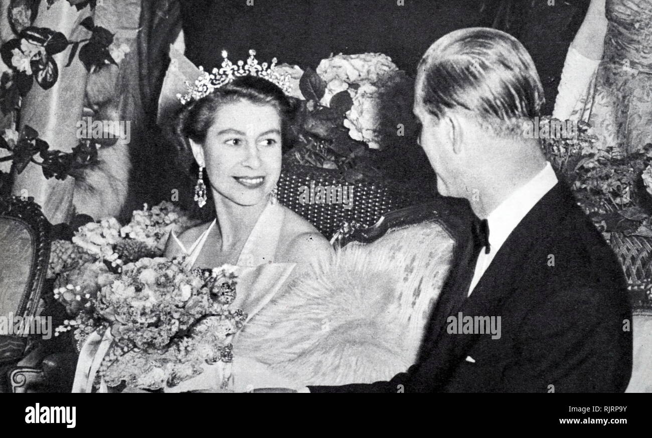 Queen Elizabeth II and the Duke of Edinburgh before the curtain rose for the Gala Performance at London's Old Vic Theatre 1953 - Stock Image