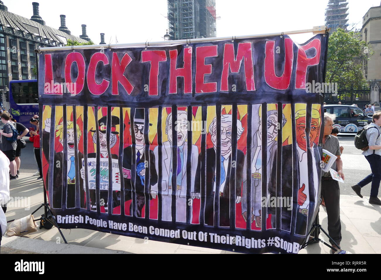 Anti-Trump; Anti-Brexit protest banner; London; England 2018. Image shows: Boris Johnson, William Rees-Mogg and David Davis (Pro-Brexit leaders) and US President Donald Trump behind bars. - Stock Image