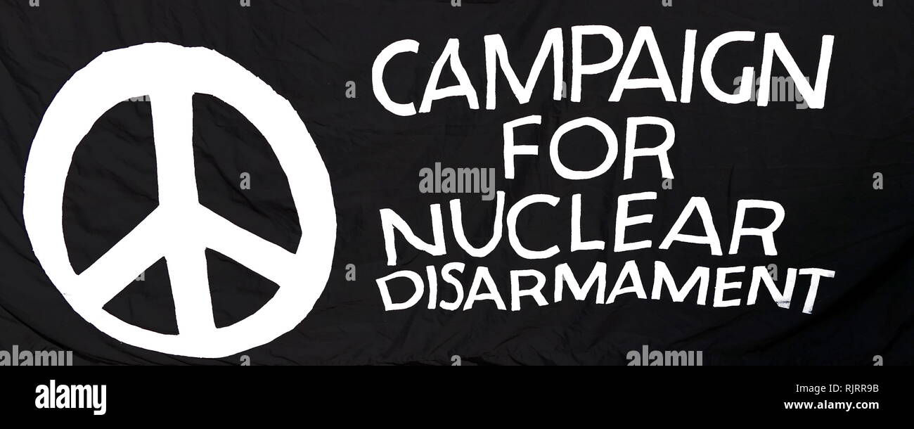 Campaign for Nuclear disarmament sign. The Campaign for Nuclear Disarmament (CND) is an organisation that advocates unilateral nuclear disarmament by the United Kingdom, international nuclear disarmament and tighter international arms regulation through agreements such as the Nuclear Non-Proliferation Treaty. CND began in November 1957 - Stock Image