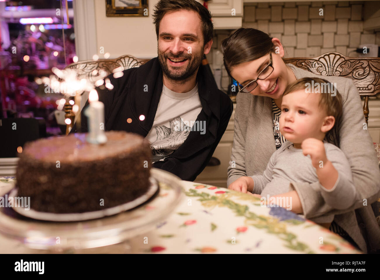 Couple And Baby Boy With First Birthday Cake Stock Photo Alamy
