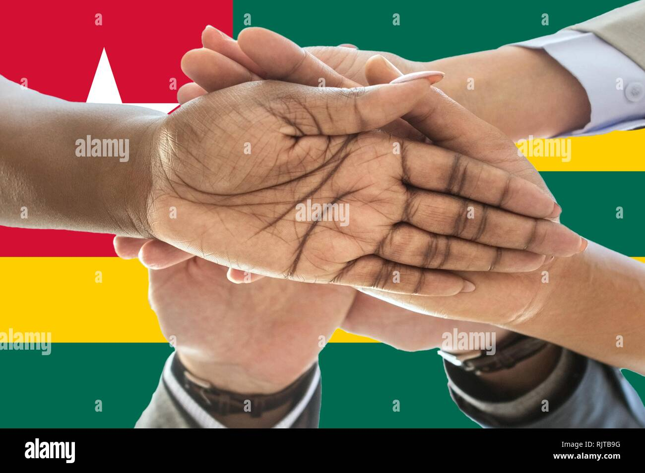 togo flag, intergration of a multicultural group of young people - Stock Image
