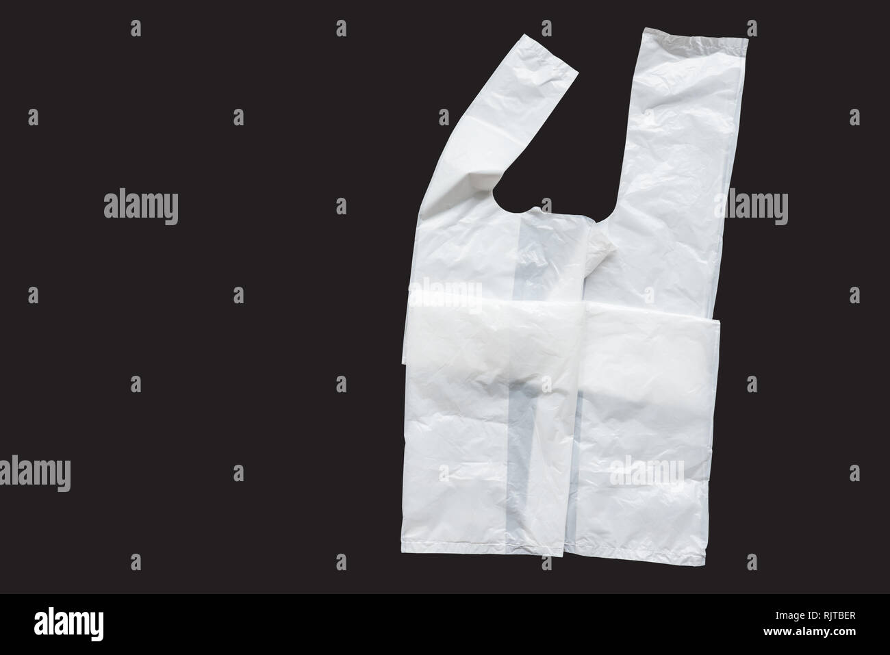 Plastic bag on a dark background - Stock Image