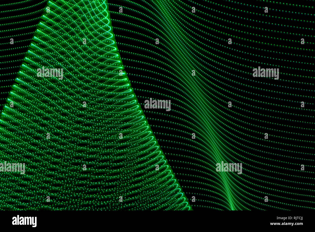 Abstract curved lines of green colors. Concept of renewable or green energy. Abstract art with lights Stock Photo