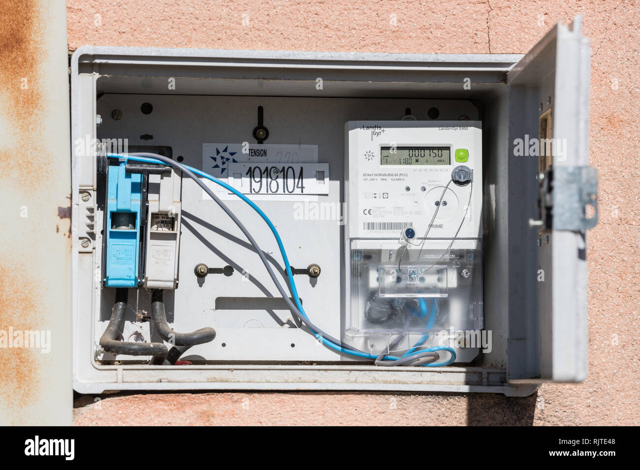 Open electric panel and meter in a street in Caceres, Extremadura, Spain. - Stock Image